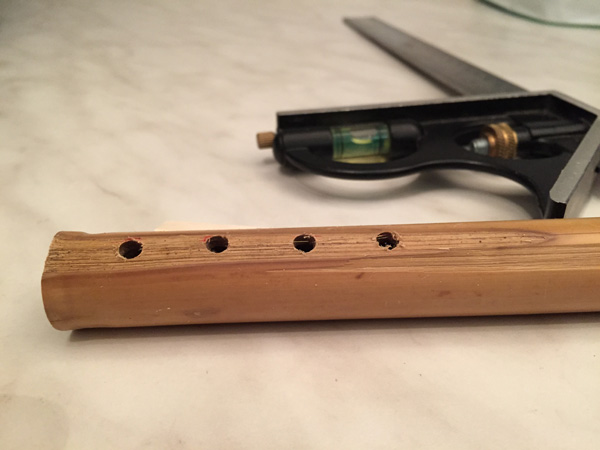 Drilling the holes in a flute